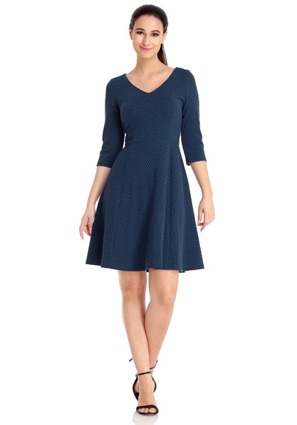 Front full body shot of model wearing navy geometric textured casual skater dress