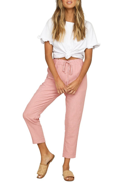 Front full body shot of model wearing pink drawstring-waist rolled-up cropped pants