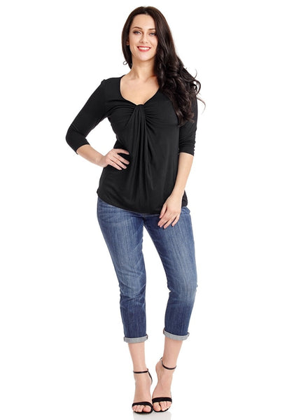 Front full body shot of model wearing plus size black twist knot front V neckline top