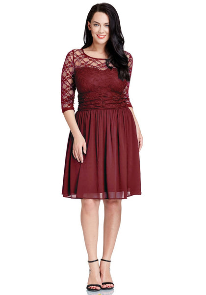 Front full body shot of model wearing plus size burgundy lace crop-sleeves skater dress