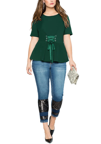 Front full body shot of model wearing plus size dark green lace-up waist blouse
