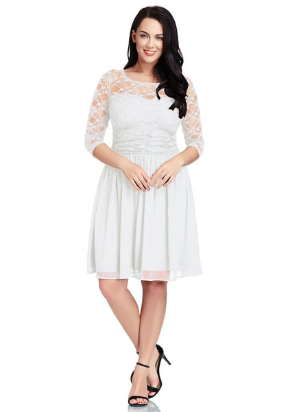 Front full body shot of model wearing plus size white lace crop-sleeves skater dress