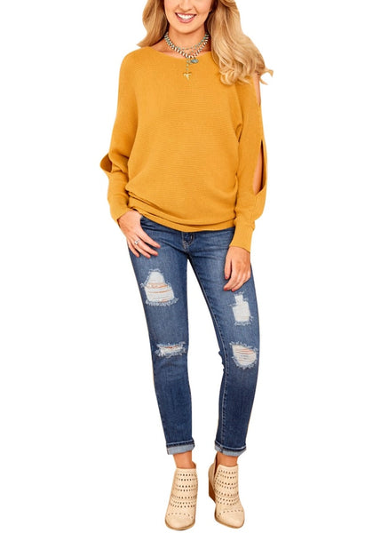 Front full body shot of woman in mustard yellow cutout slit sweater