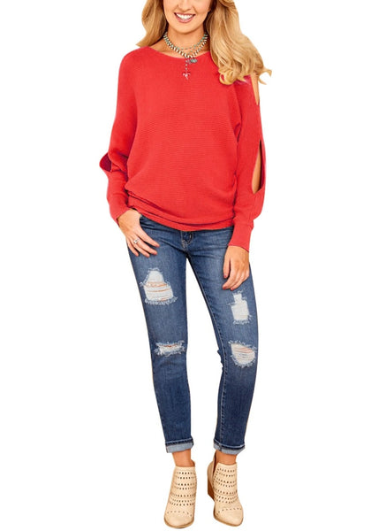 Front full body shot of woman in red cutout slit sweater