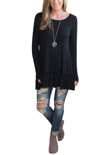 Front full body shot of woman wearing black layered ruffle-hem long sleeves tunic