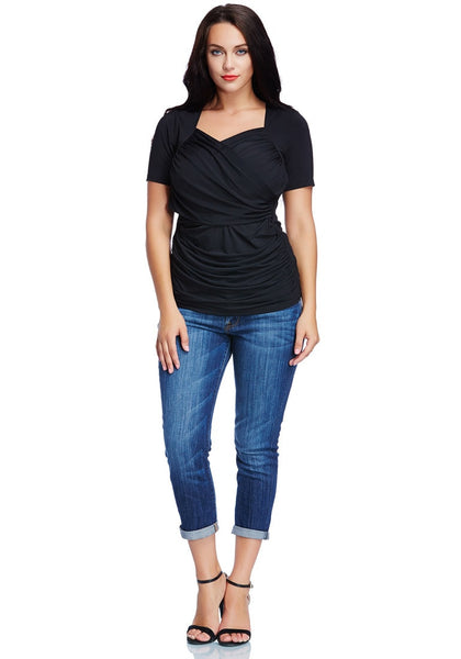 Front full body shot of woman wearing plus size black ruched surplice top