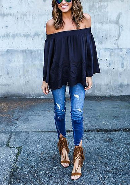 Front full body view of model wearing navy blue off-shoulder hollow out hem top