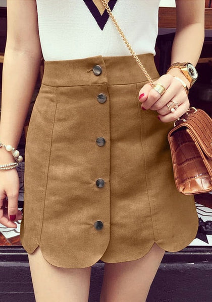 Front of girl's brown suede scallop hem miniskirt