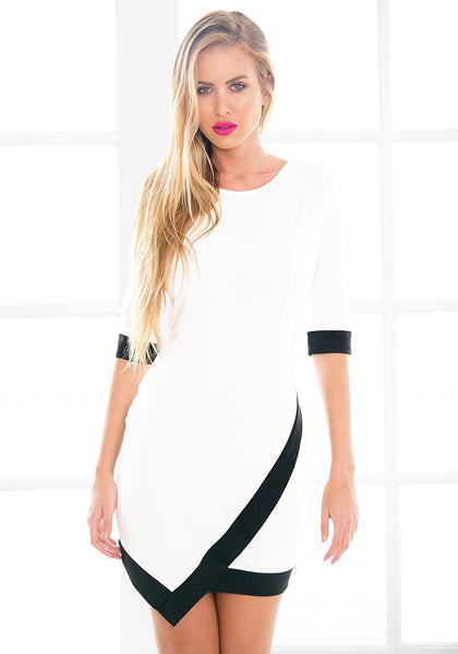 Front of model in asymmetrical wrap style dress