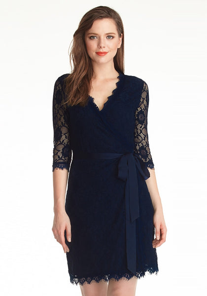Front  of model in navy blue lace overlay plunge wrap-style dress