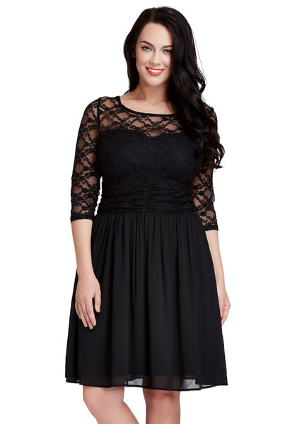 Front shot of dark-haired model in black lace crop-sleeves skater dress