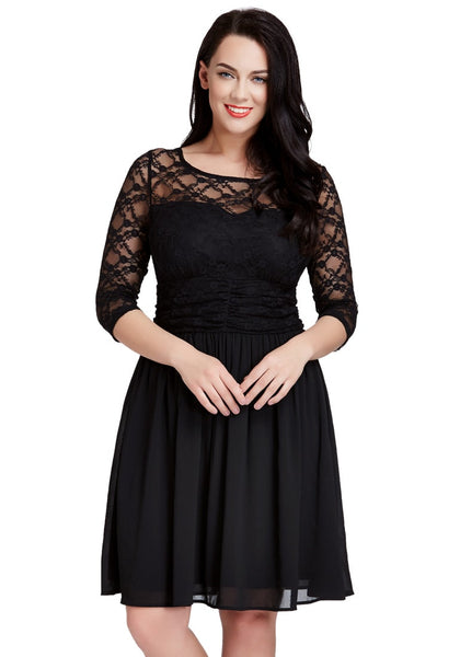 Front shot of dark-haired woman in black lace crop-sleeves skater dress