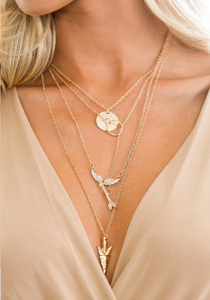 Front shot of  four-chain gold necklace