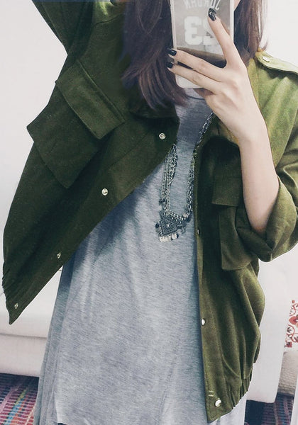 Front shot of girl  in moss green button-down military jacket and selfie