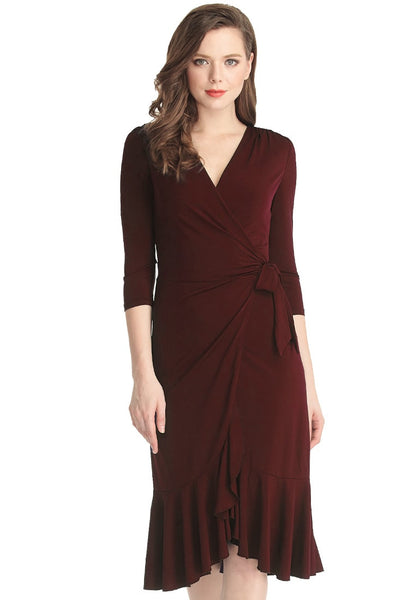 Front shot of lady in Bulgarian rose asymmetrical ruffled wrap dress