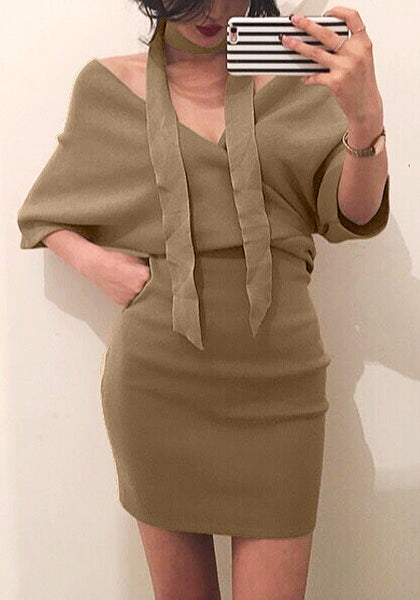 Front shot of lady in khaki wrap  pencil dress