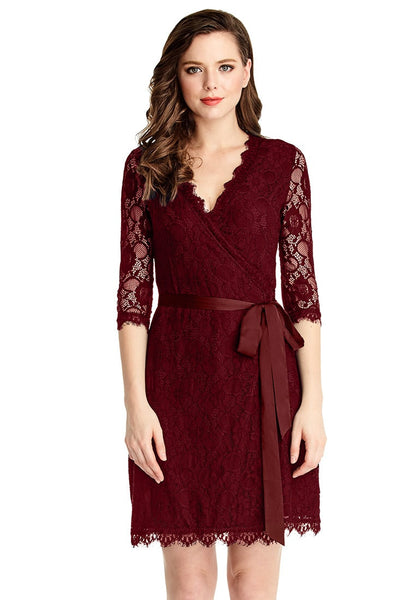 Front shot of model in burgundy lace overlay plunge wrap-style dress