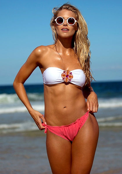 Front shot of model in hot pink floral jewelry bikini set