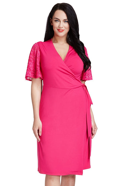 Front shot of model in hot pink plunge wrap-style dress
