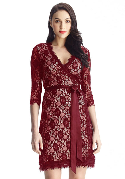 Front shot of model in maroon lace overlay plunge wrap-style dress