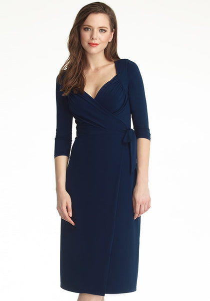 Front shot of model in navy blue sweetheart neckline wrap dress