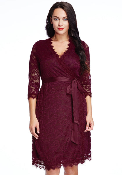 Front shot of model in plus size burgundy lace crop sleeves wrap