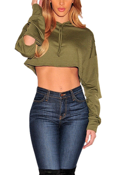 Front shot of model wearing olive green ripped hoodie crop top