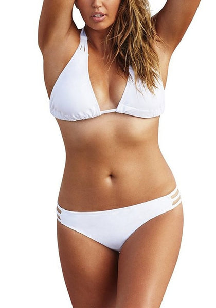 Front shot of plus-size model in white three-straps halter bikini set