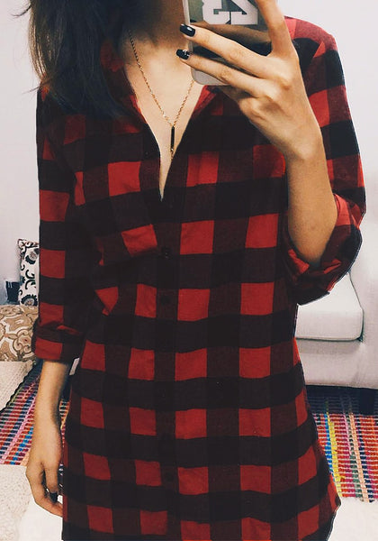 Front shot of pretty model in plaid flannel tunic shirt