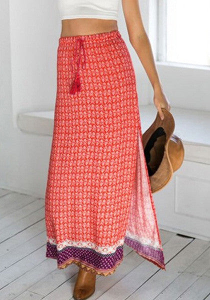 Front shot of red printed maxi skirt worn by model