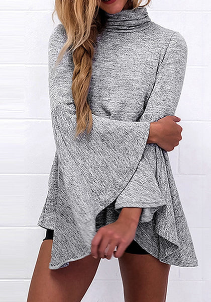 Front shot of woman in grey bell-sleeved back-slit top