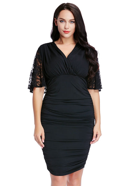 Front shot of woman in plus size black ruching bodycon dress
