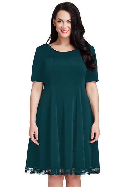Front shot of woman wearing plus size deep green short-sleeves skater dress