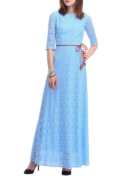 Front side view of brunette posing in a powder blue maxi dress
