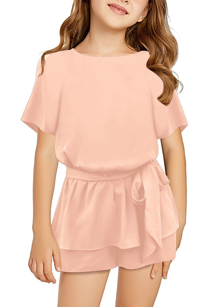 Front view od model wearing pink keyhole-back belted peplum girls romper