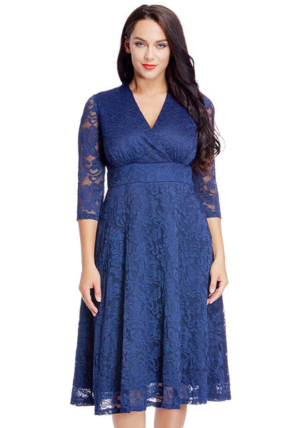 Front view of beautiful model wearing plus size royal blue lace surplice midi dress