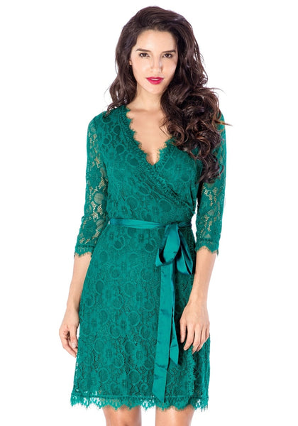 Front view of beautiful model wearing teal lace overlay plunge wrap-style dress