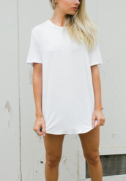 Front view of blonde model in white curved hem classic tee