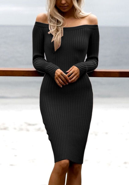 Front view of blonde woman in black off-shoulder knitted dress