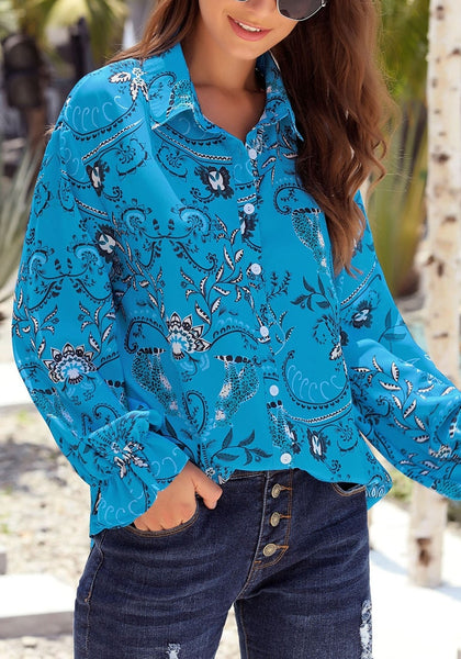 Front view of blue V-neckline boho floral-print button-up loose top