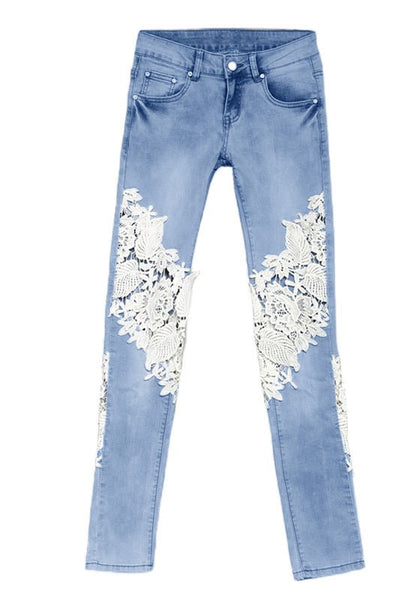 Front view of blue lace-paneled skinny jeans