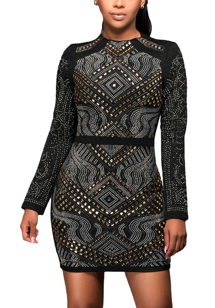 Front view of brunette model in black jeweled quilted dress