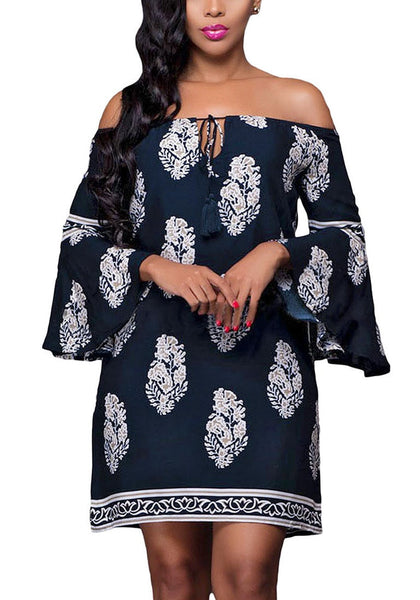 Front view of brunette model in navy floral print off-shoulder shift dress