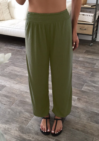 Front view of girl in army green elastic waist lounge pants