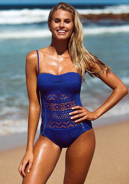 Front view of girl in blue lace halter swimsuit