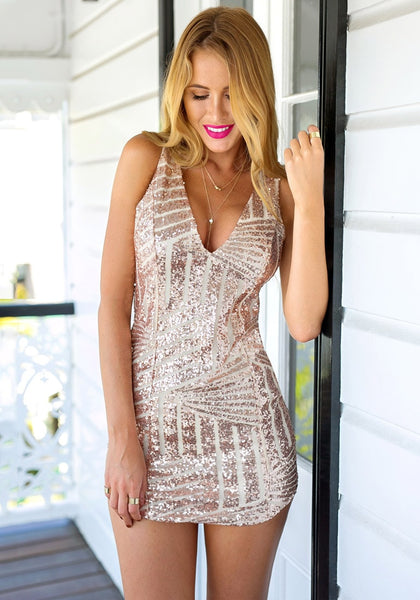 Front view of girl in champagne sequin party dress