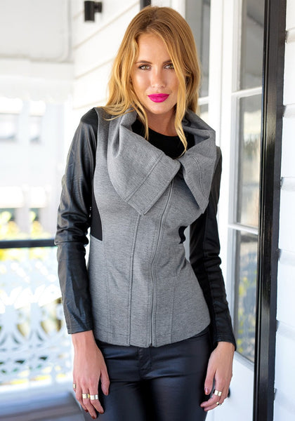 Front view of girl in grey PU-sleeve cowl neck jacket