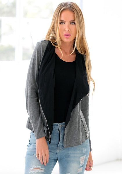 Front view of girl in grey oblique zipper cardigan