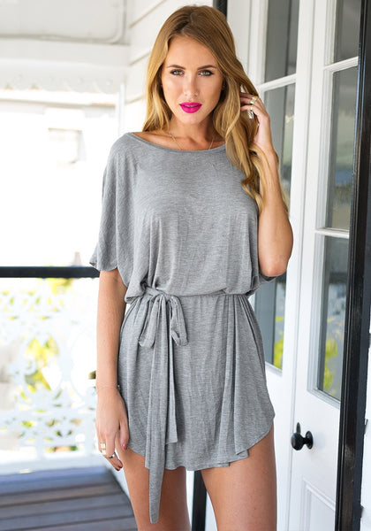 Front view of girl in grey t-shirt dress