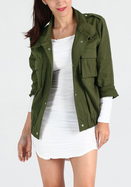 Front view of girl in moss green button-down military jacket